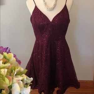 Burgundy party/prom dress, sleeveless w sequins.